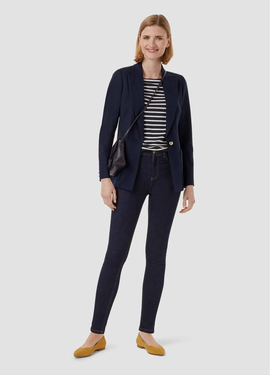 Women's top with horizontal stripes in black and white, paired with a navy blazer, blue jeans and a crossbody bag in black, by Hobbs.