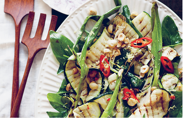 Grilled courgettes with hazelnutsartfully arranged on a platter in a recipe by Sarah Britton