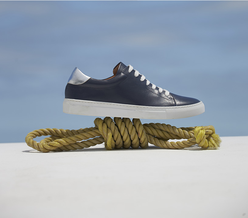 Blue Trainers balancing on rope