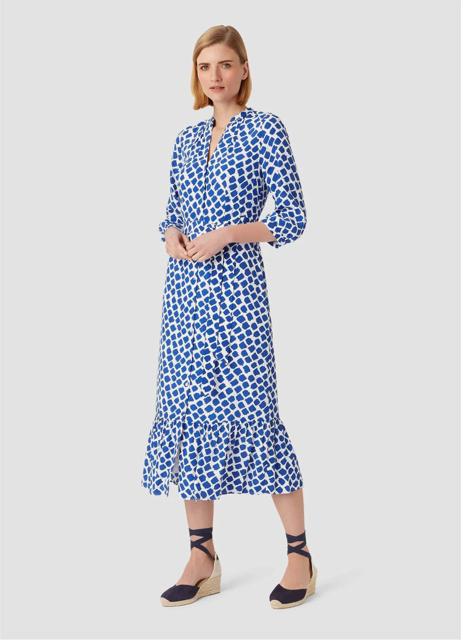 Midi length shirt dress with frill details in blue and white worn with espadrille wedge sandals by Hobbs.
