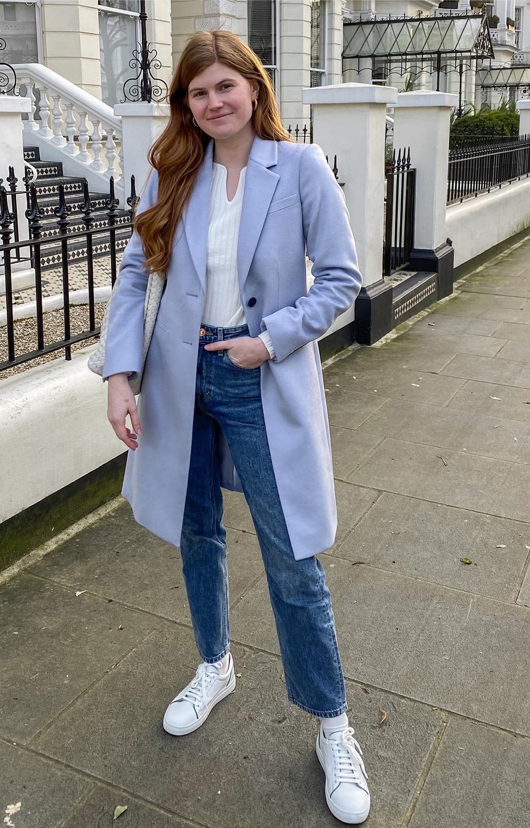 Fashion blogger @mollie_moore__ photographed on a walk wearing Hobbs Tilda blue coat, Vanessa jumper,Sukey jeans and Freda trainers.