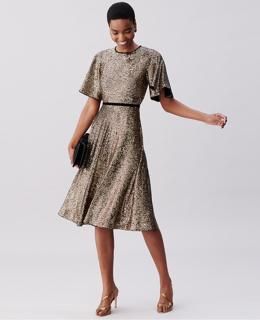 Gold Sequin Midi Dress with Black Clutch Bag and Gold Sandals