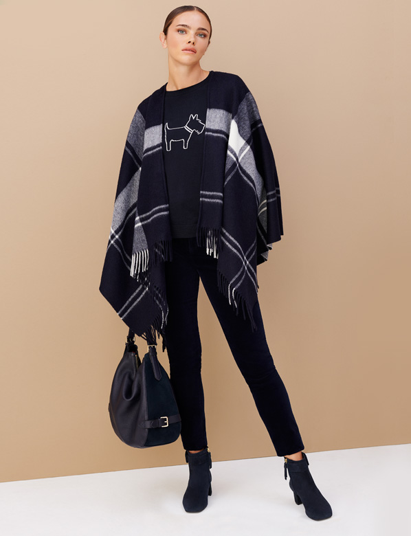 Monochrome Tartan Cape on Black Dog Print Jumper and Skinny Jeans
