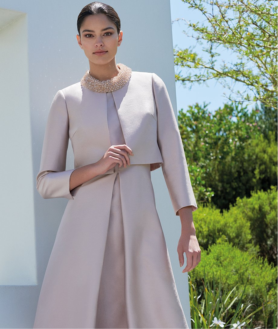 Pink embellished occasion dress with a matching pink jacket by Hobbs.