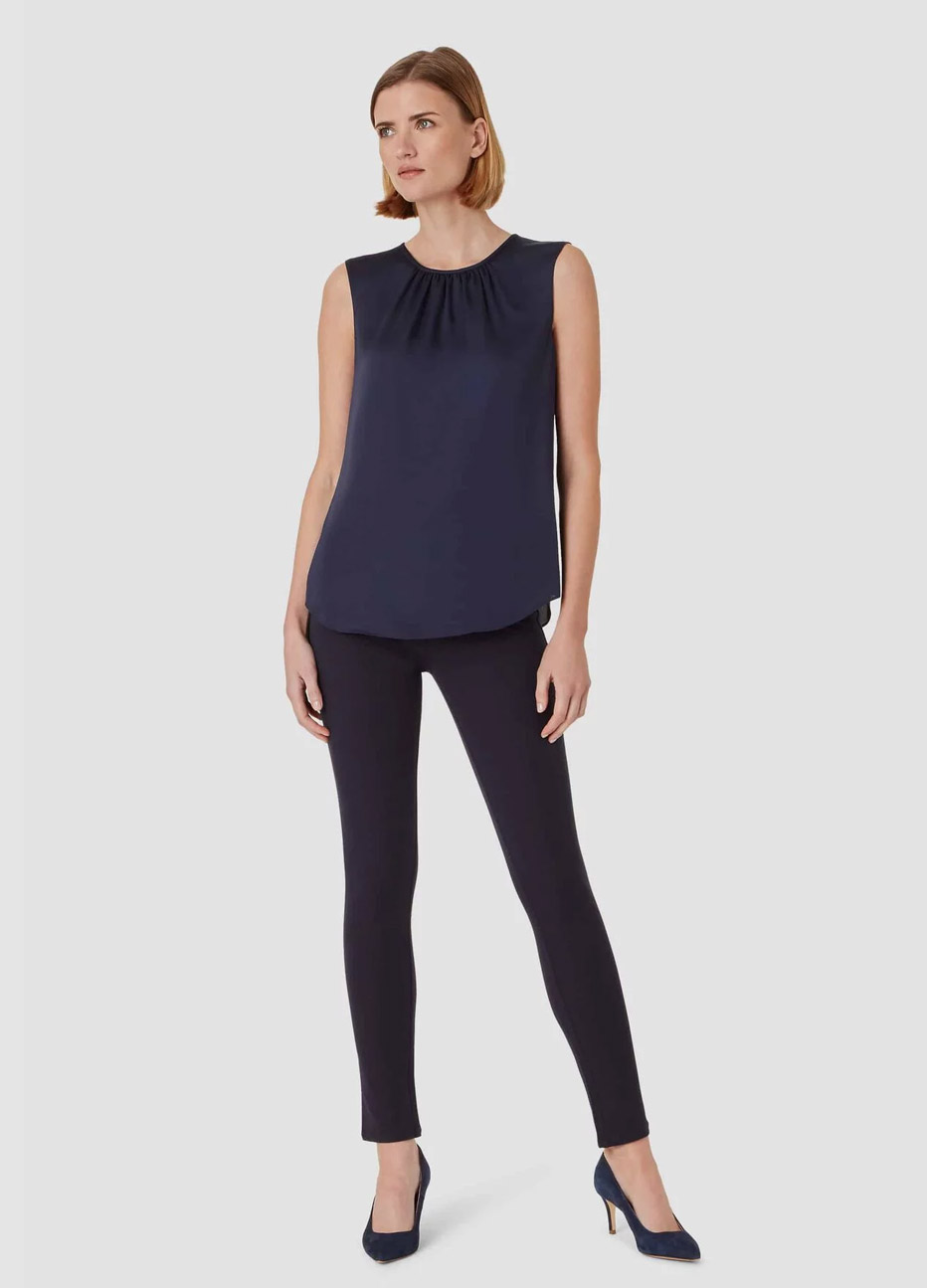 Satin blouse in navy worn with navy jeans by Hobbs.