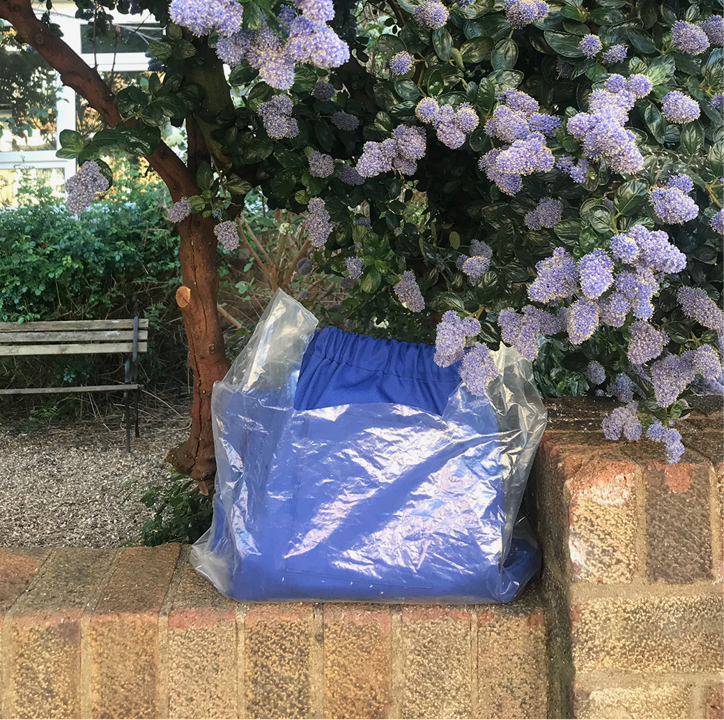 The material to make scrubs for the NHS left outside Laura's home by Scrub Hub