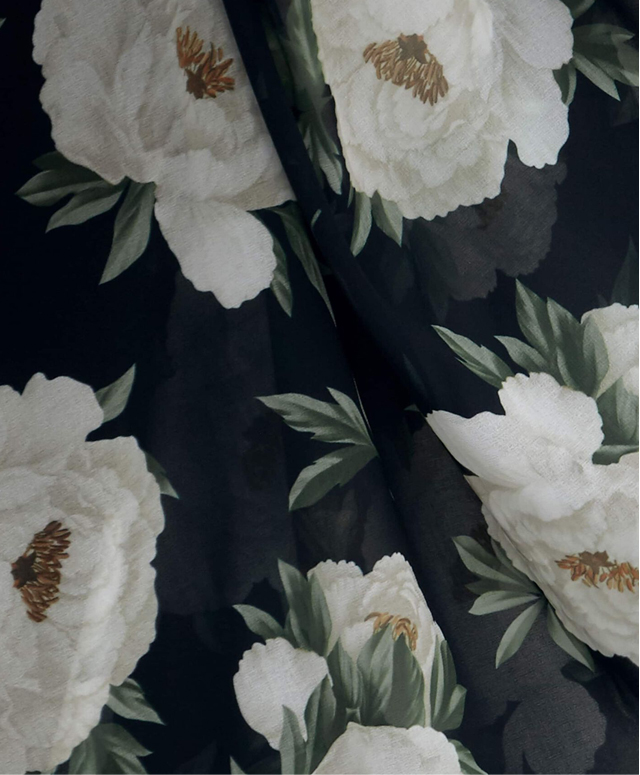 Close-up of peony floral print fabric.