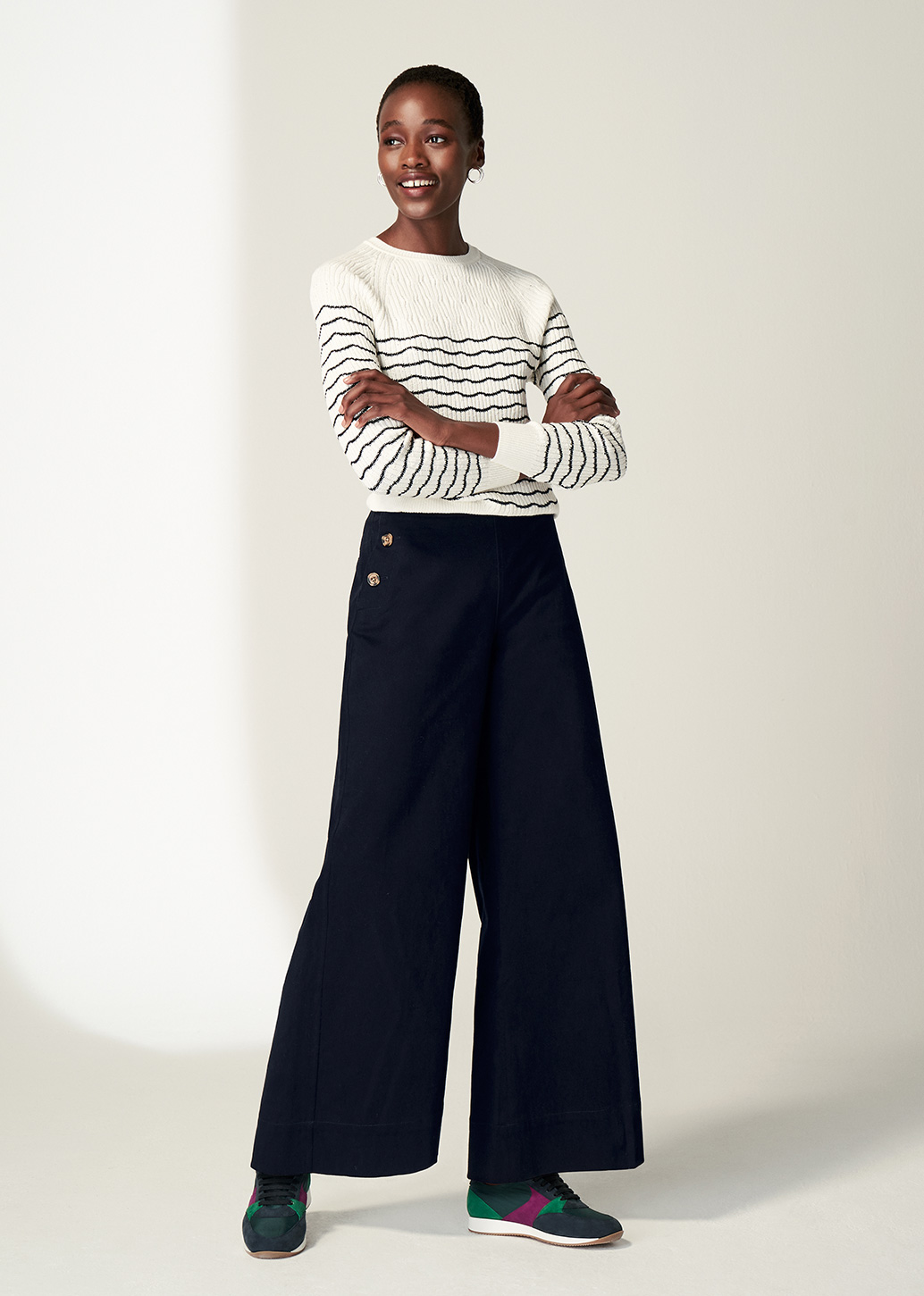 Model wears Hobbs Daniella jumper with Simone wide leg trousers.