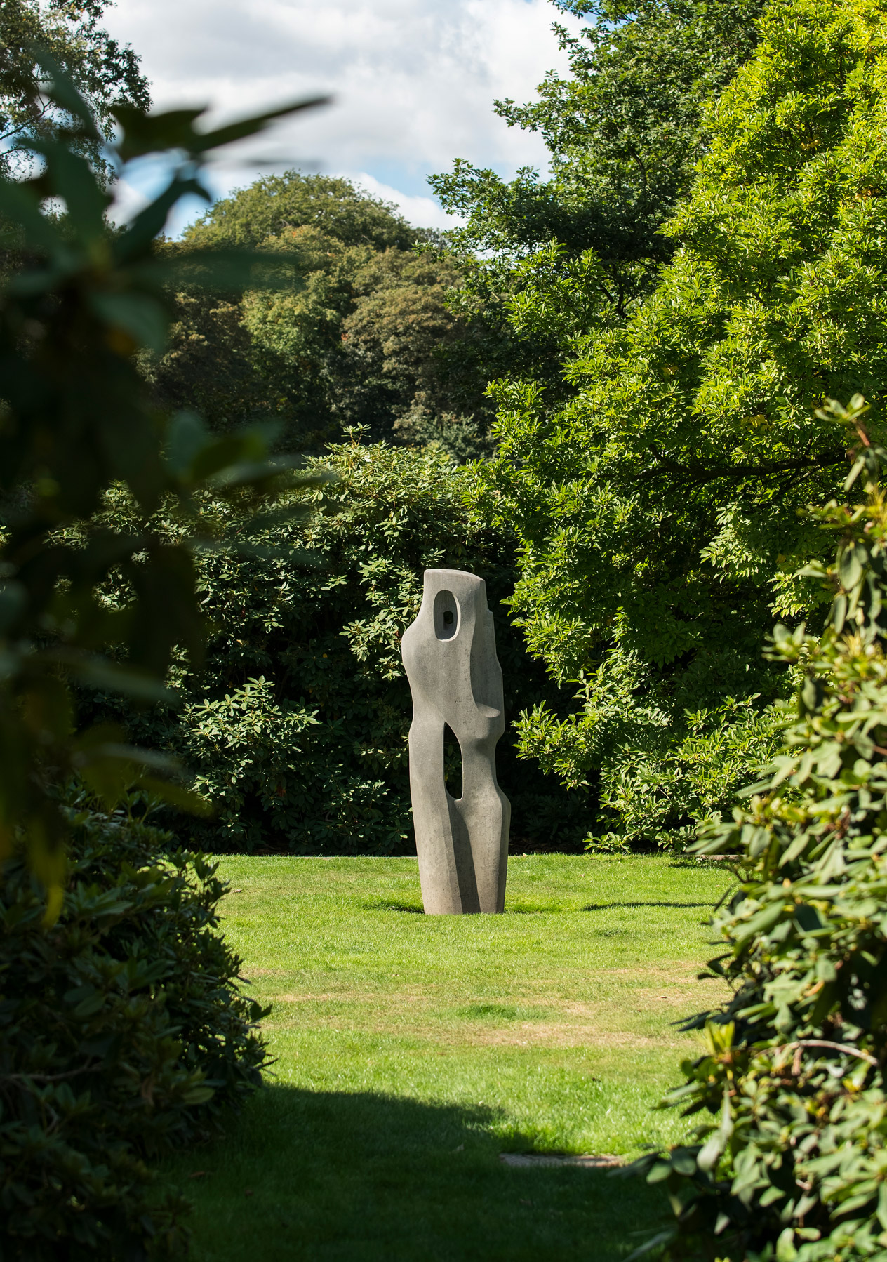 A sculpture appears in the opening amoungst the greenery of hampstead