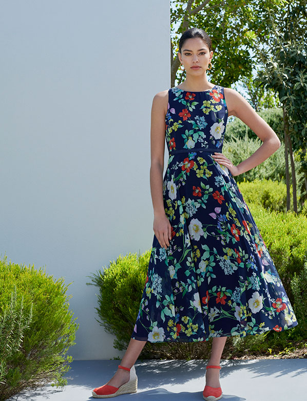Navy carly dress with multicoloured floral print.