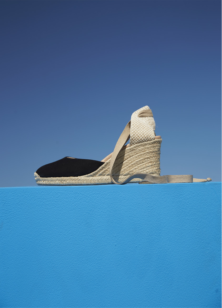 Espadrille wedge sandal in black with an ankle strap feature by Hobbs. A versatile choice, wear with a formal dress or a floral dress for all types of events.