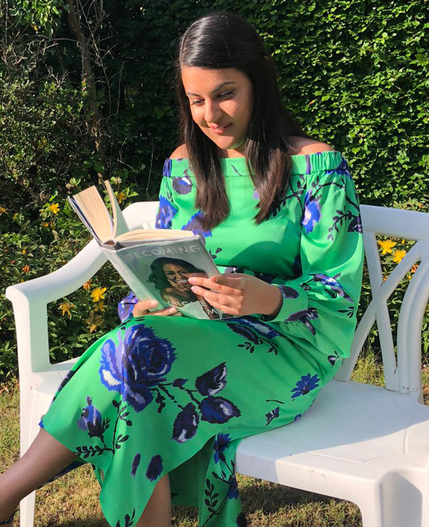 Priya reads Michelle Obama's Becoming at home in the Miriam Dress