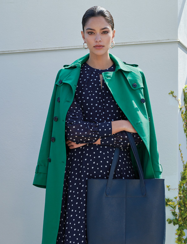 Green trench coat with spotty dress