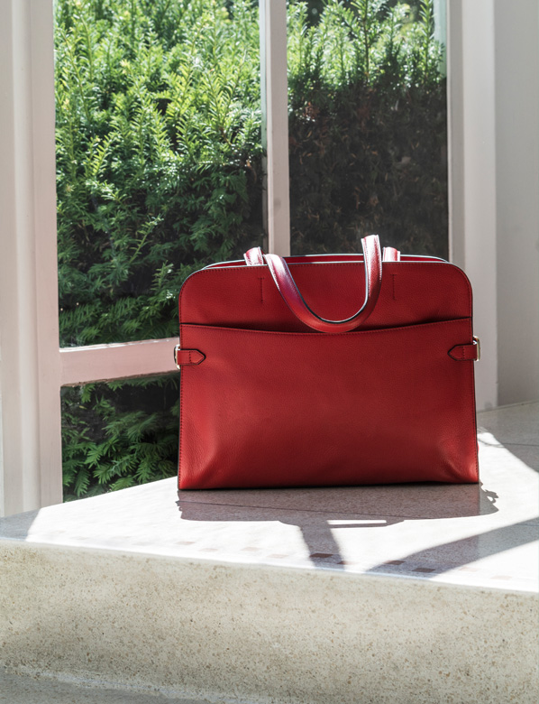 Red Tote Bag next to a Window