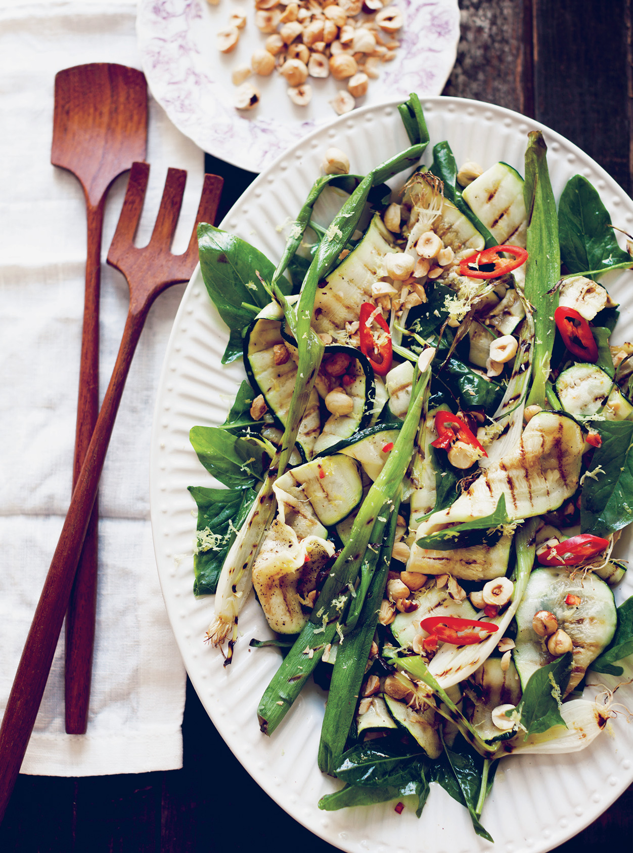 Sarah Britton's Grilled Courgette with Spring Onion and Hazelnut styled on a plate