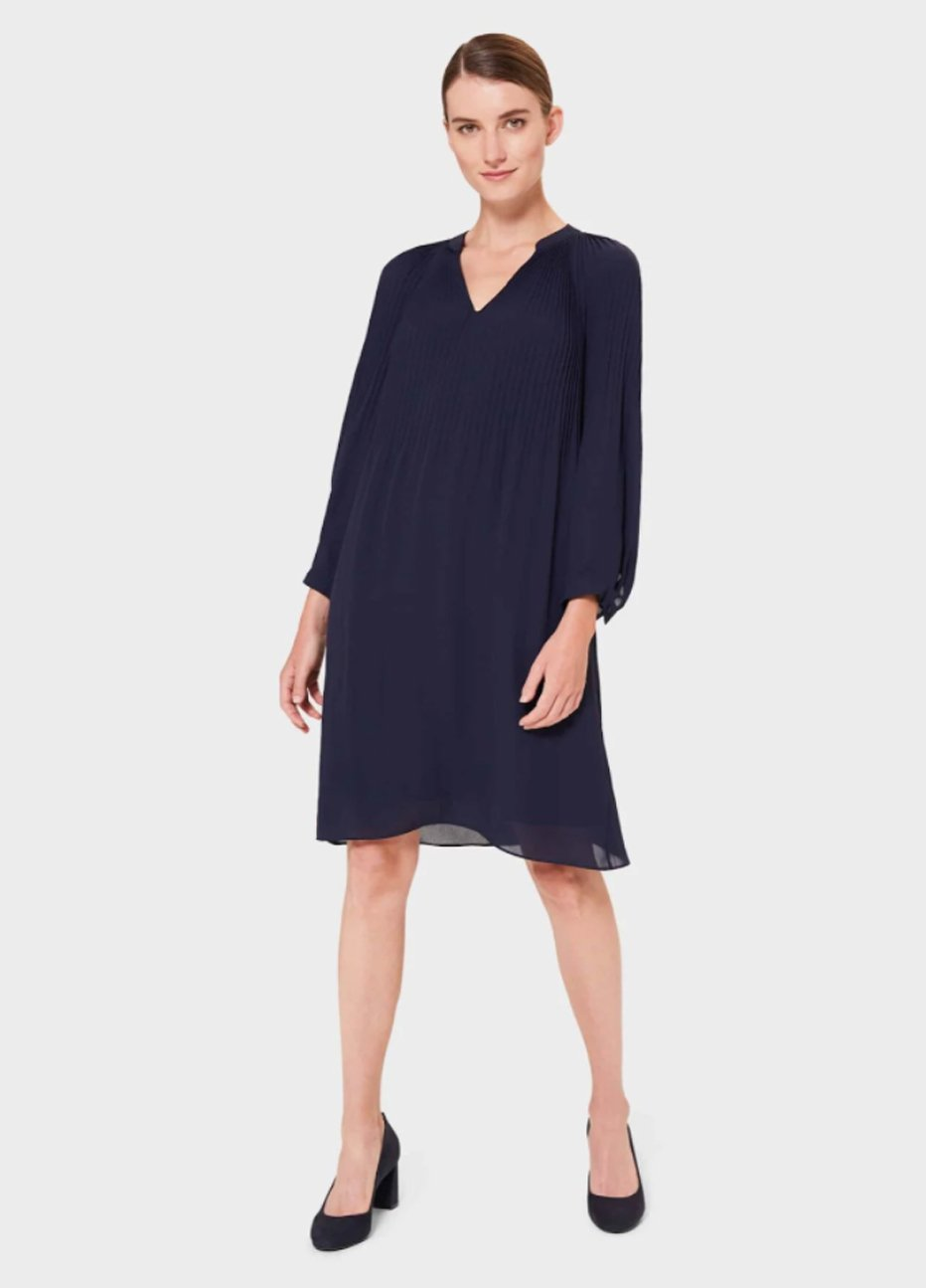 Black tunic dress with block heeled court shoes in black by Hobbs.