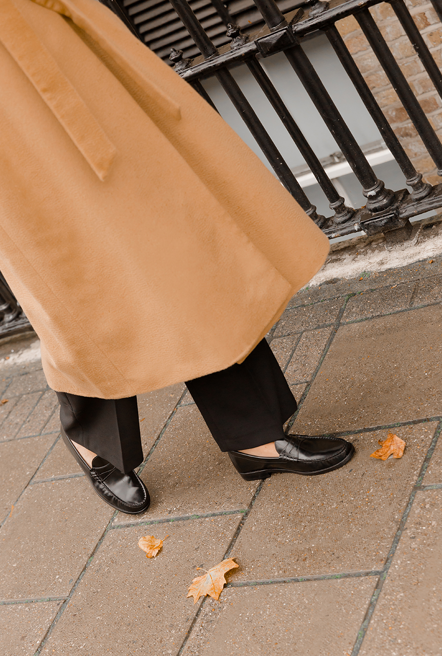 Hobbs' Product Director, Sally Ambrose, photographed wearing black loafers.