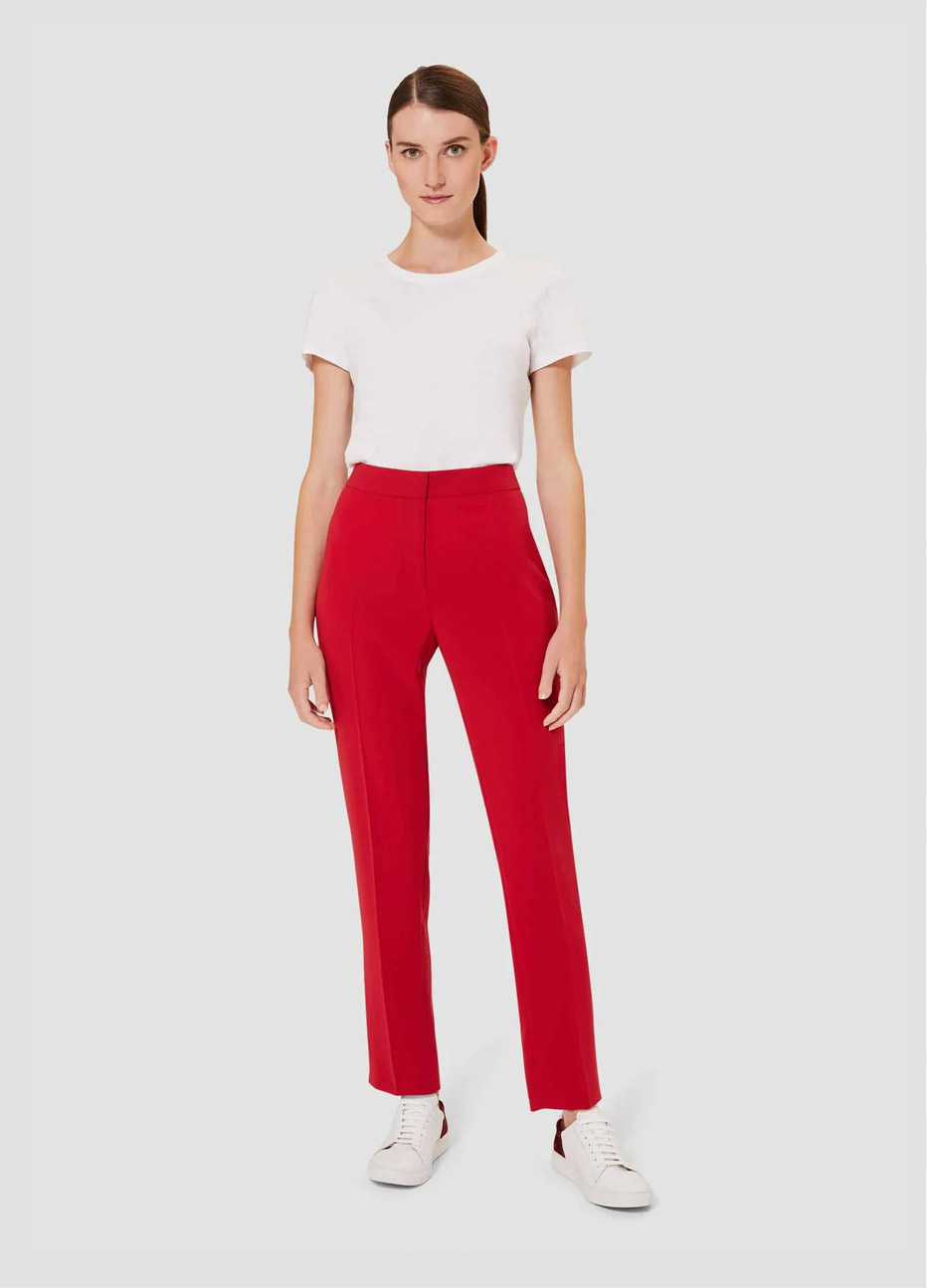 White tshirt with red tailored trousers worn with white trainers by Hobbs.