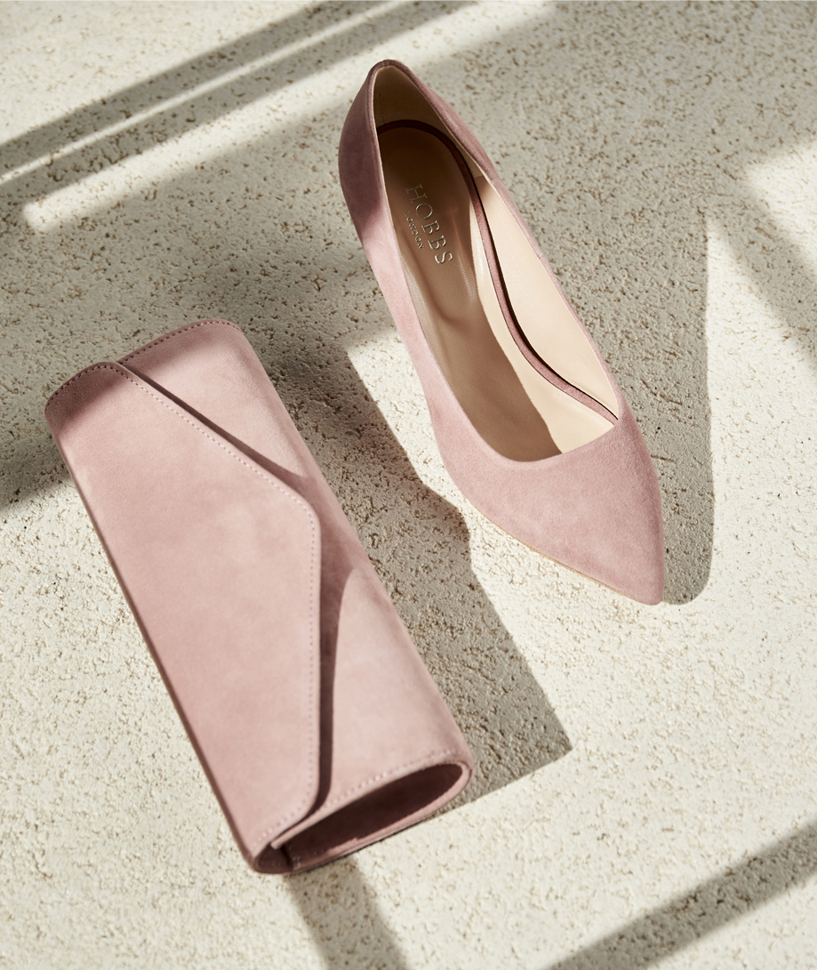 Pink court shoes with matching pink clutch by Hobbs, the ideal accessories for a mother of the bride outfit.