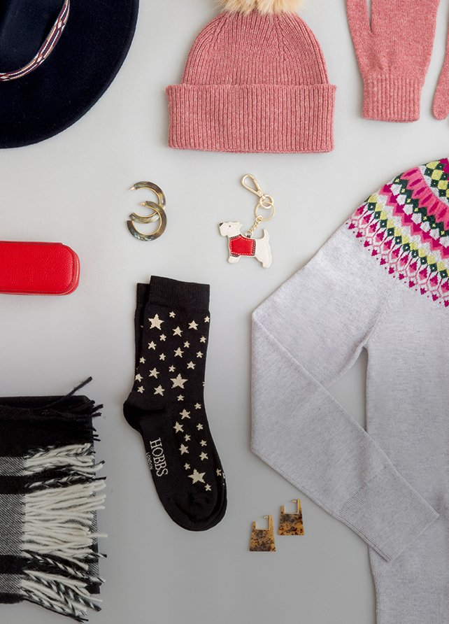 A selection of Christmas gifts including a Fair Isle sweater, check scarf, hat and gloves.