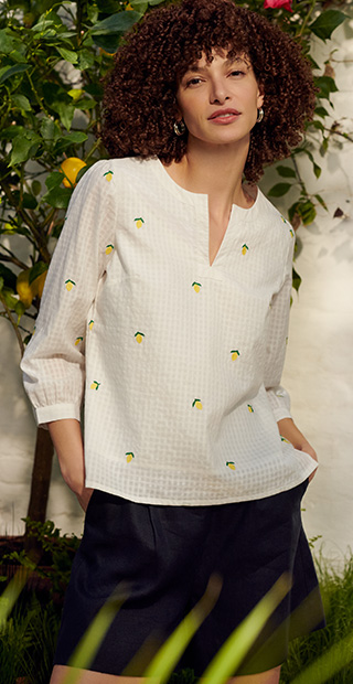 White Sleeved Top with Small Lemons Print over Navy Shorts