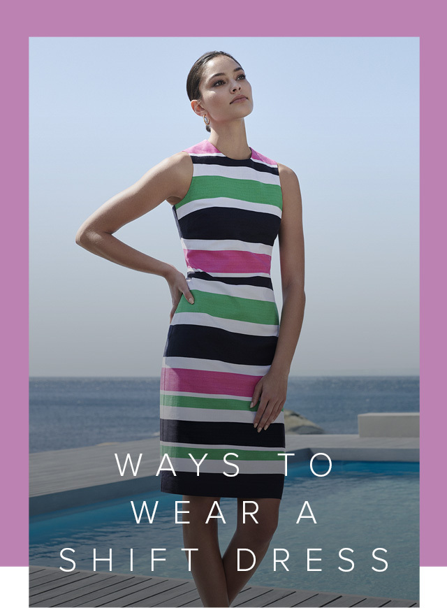 Hobbs model posing next to the pool by the seaside, wearing a multi coloured shift dress in pink, white, green and black paired with flat sandals in white.