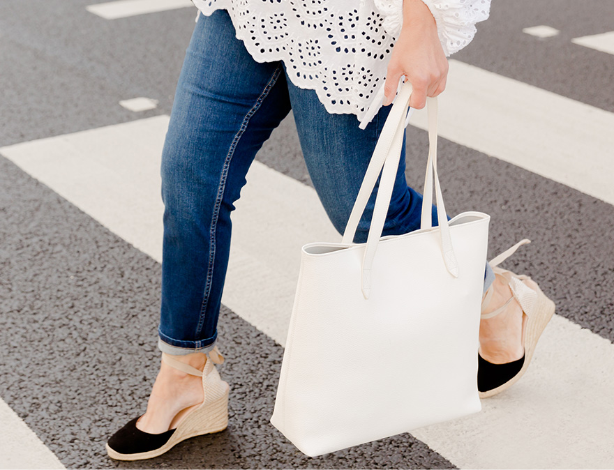 A snapshot image of an outfit featuring blue jeans, black espadrilles and a white tote bag worn by Hobbs UK & International Visual Specialist, Selena Trkuljia.