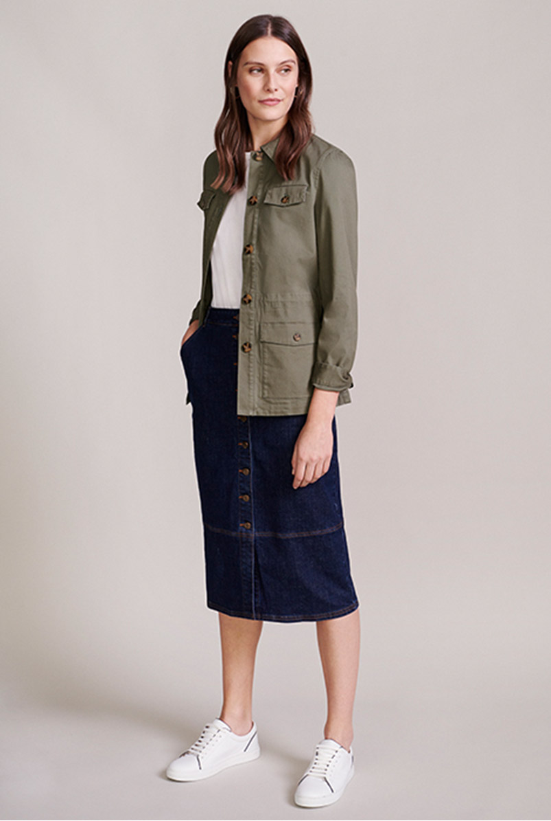 Model wears a field jacket, white tee and button-through denim skirt.