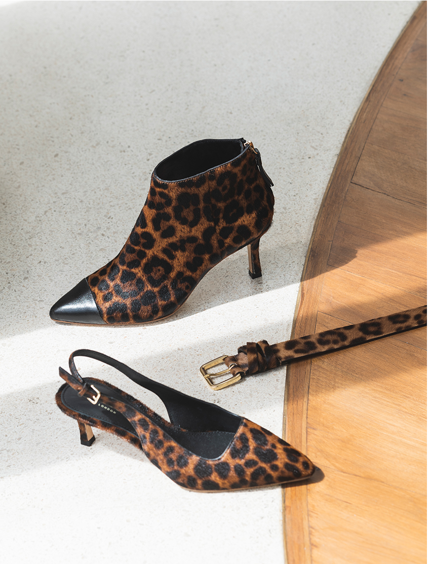 A selection of leopard print ankle boot, slingback kitten heels and belt