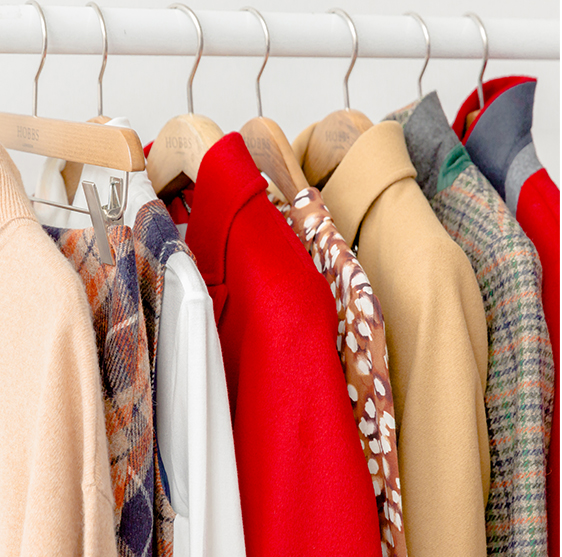 Image of a rail showing autumn knitwear, coats and dresses.