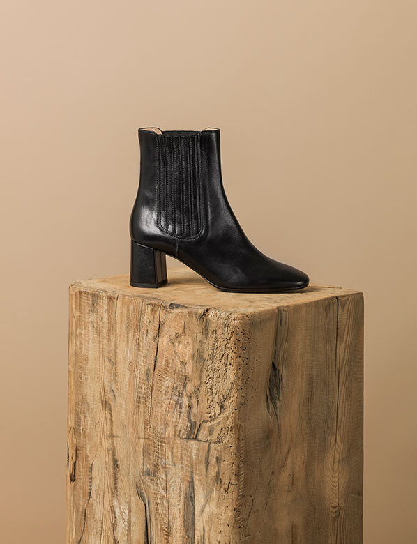 Black panel boot on plinth