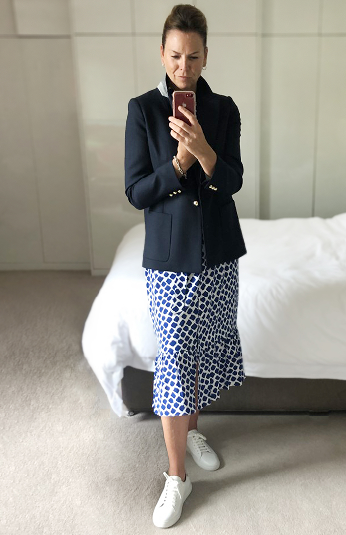 Styled for socialising, Sally teams a blue and whiite shirts dress with a navy blue blazer and white trainers.
