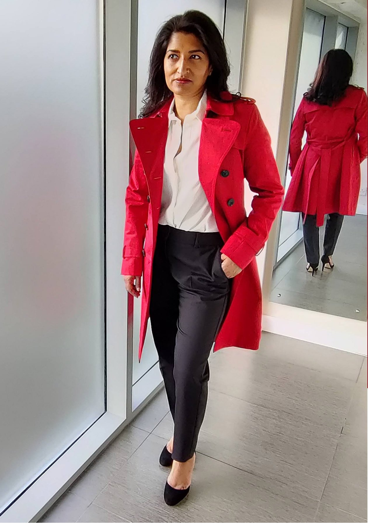 Photographed at home, fashion blogger Monika Mandal wears Hobbs petite red Saskia trench and Quin navy trousers.