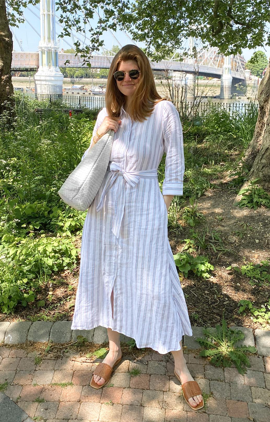 Content creator @molliemoore_ photographed at Battersea Park in London wearing Hobbs' Ciara linen dress.