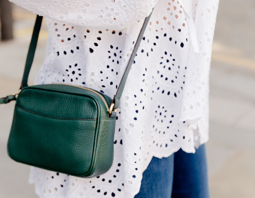 A snapshot image of an outfit featuring a white blouse and a green crossbody bag worn by Hobbs UK & International Visual Specialist, Selena Trkuljia.