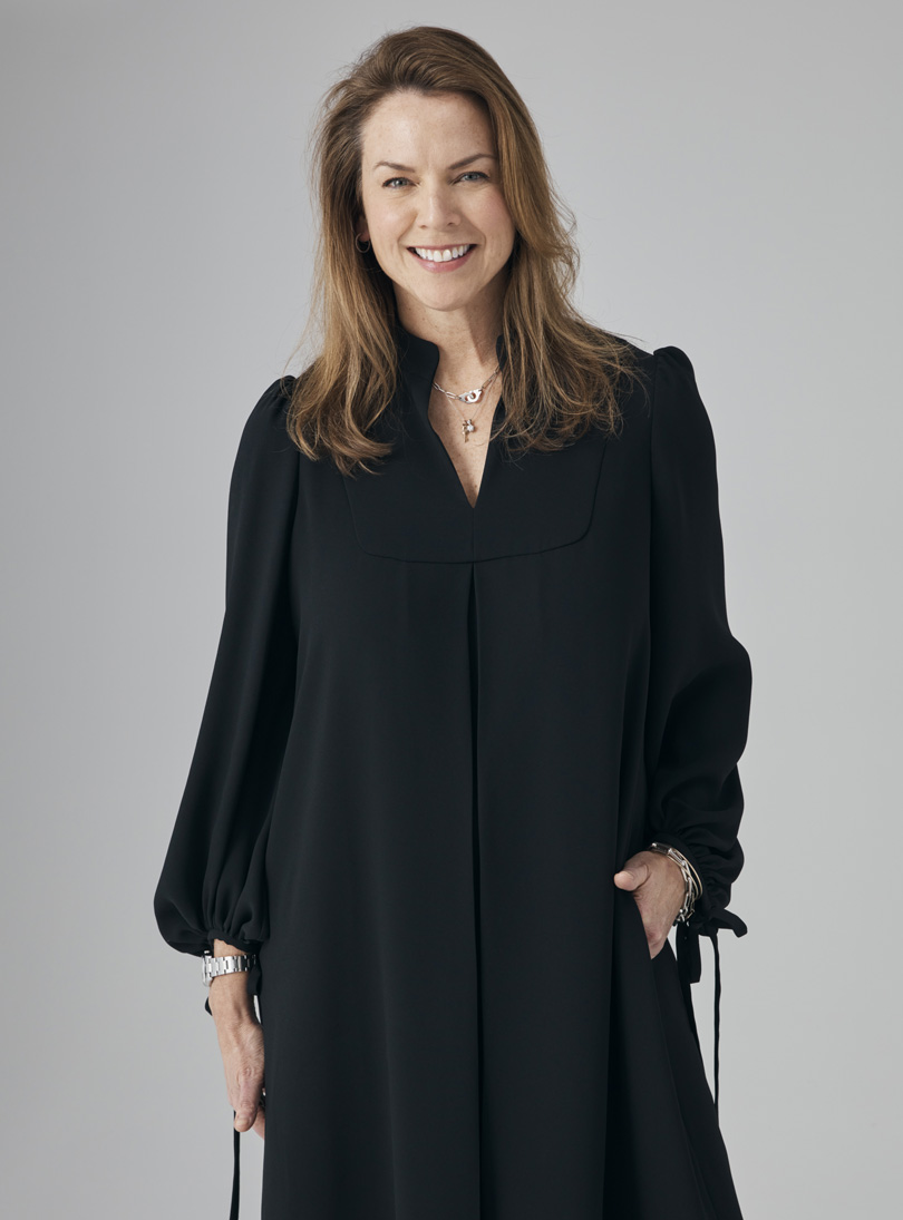 Hobbs Product Director, Sally Ambrose pictured in the loose black, Natasha Dress.