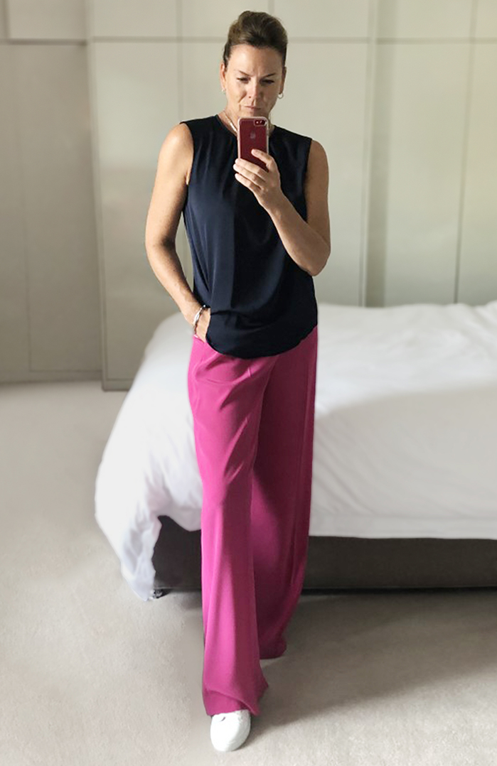 When you want to stand out pairing classic navy with a bright pink pair of palazzo style trousers works a treat.