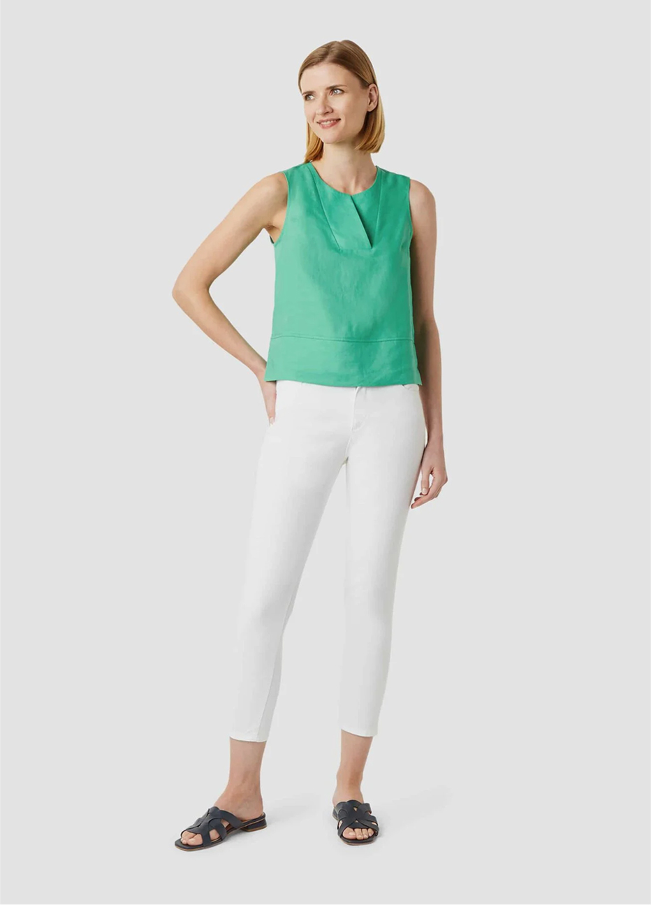 Green blouse with cropped white jeans and summer sandals in black by Hobbs.