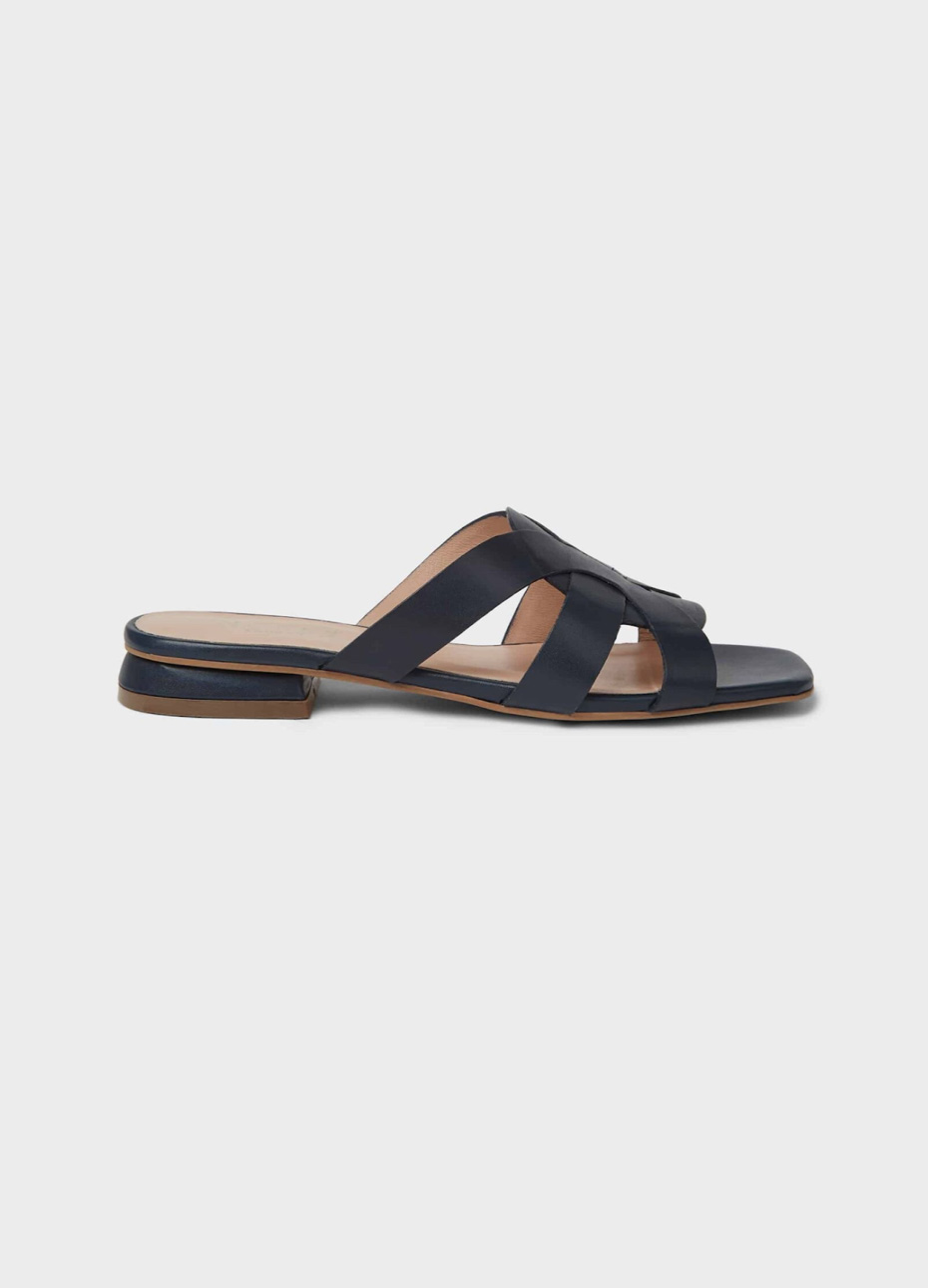 Hobbs flat leather sandal with an open back in black.