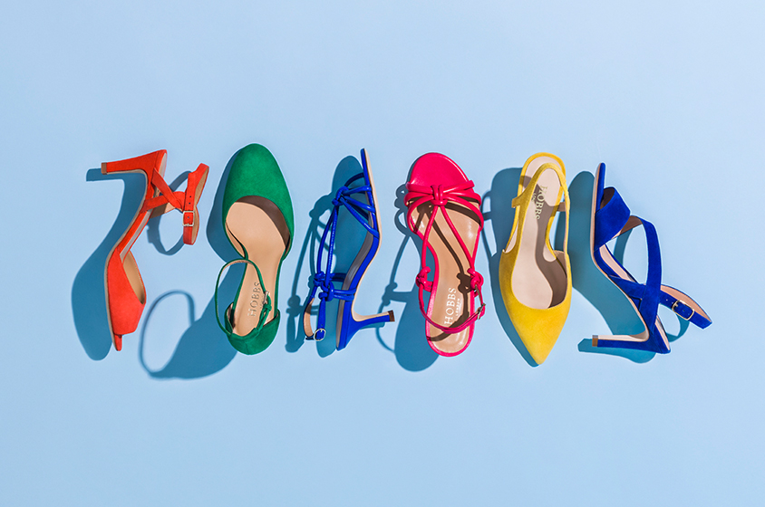Multi-coloured occasion shoes on a pale blue background