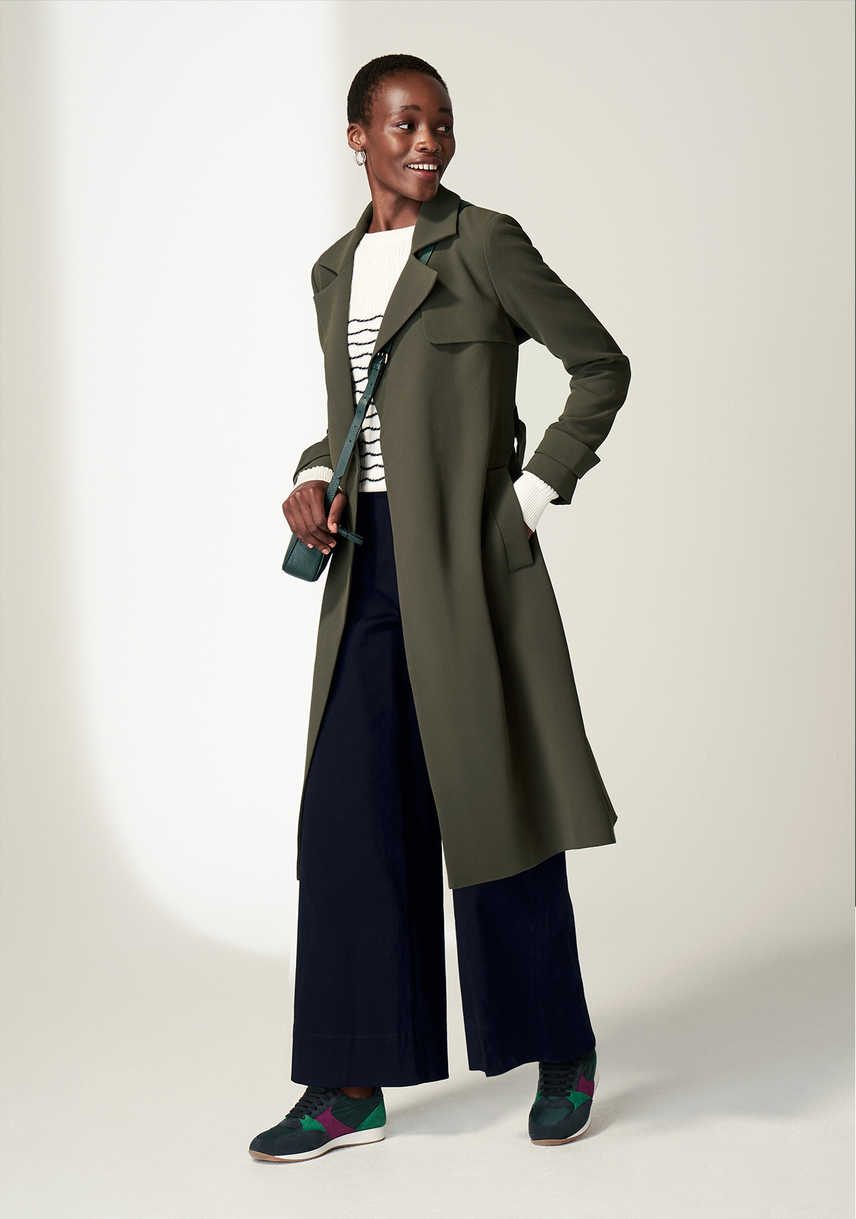 Model wears Hobbs Serena coat with Simone wide leg trousers.