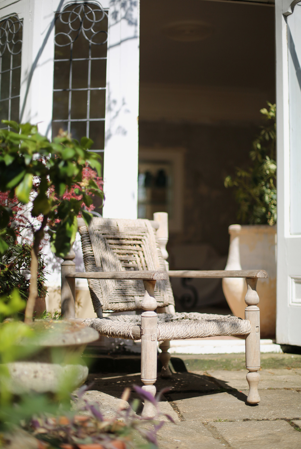 Hannah sets a chair outside in her garden to make the most of the spring sun,