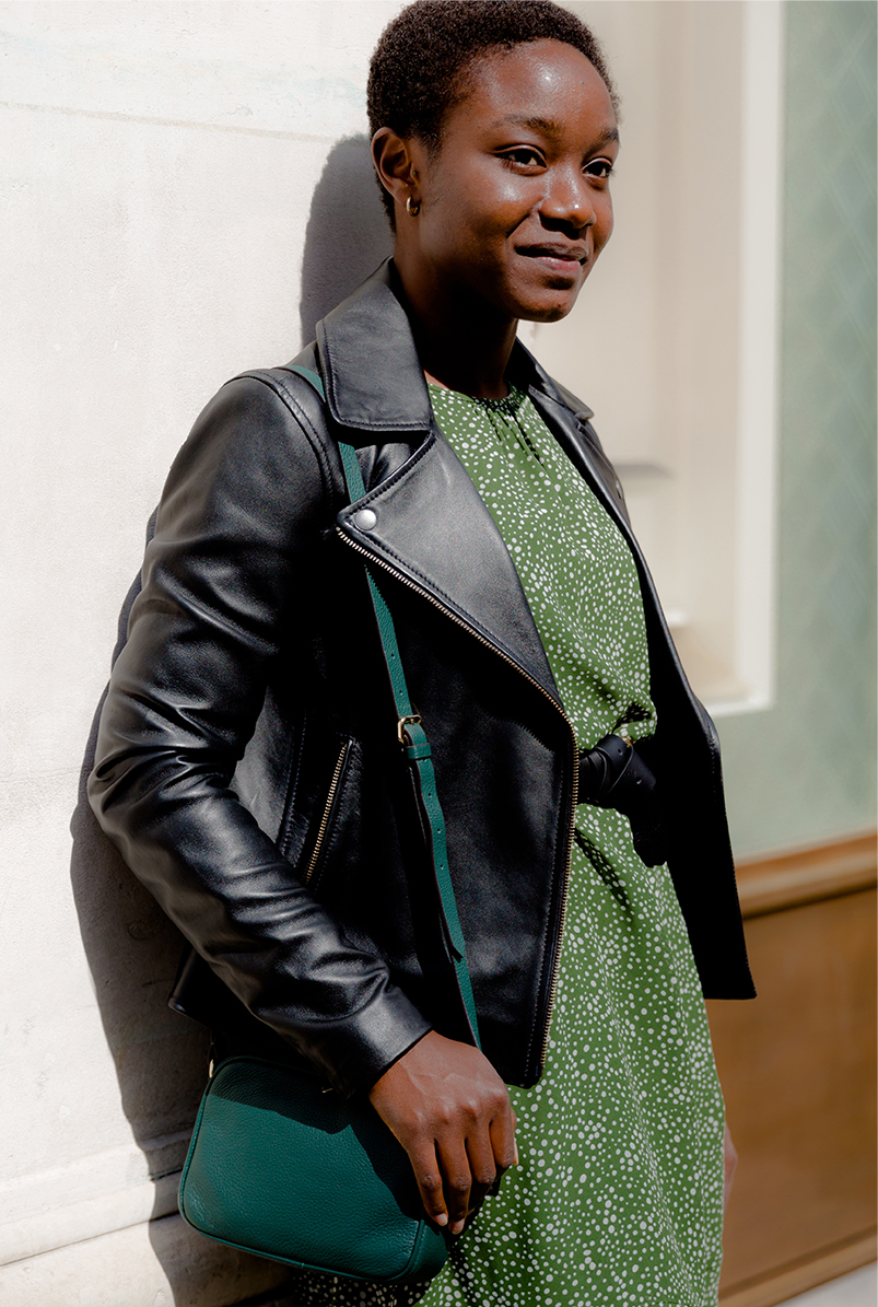 hobbs black leather jacket style with a green floral print dress and ankle boots