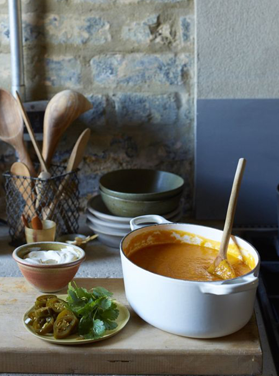 Casserole dish containing soup on a kitchen sideboard.