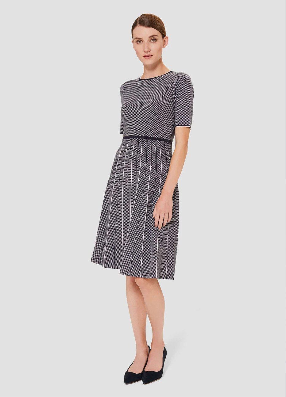 Short-sleeved fit and flare knitted dress in navy with ivory vertical stripes, paired with low heeled black court shoes, by Hobbs.