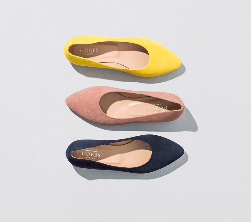 Three ballerina shoes, yellow, pink and navy