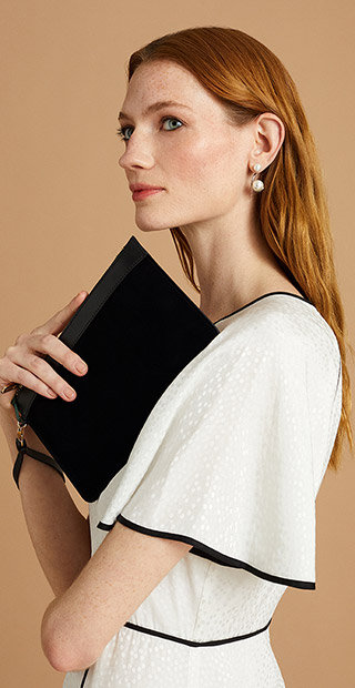 White Long Occasion Dress With Black Clutch Bag