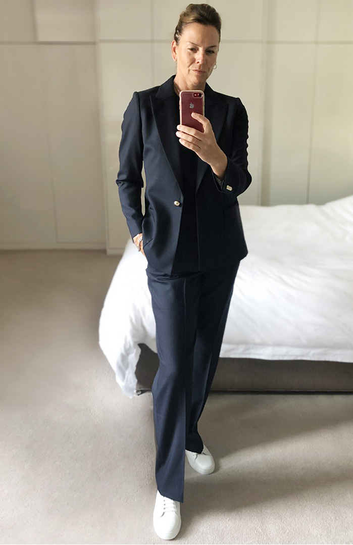 Hobbs Product Director, Sally Ambrose shows us how to style classic pieces whethe working or relaxing. Here, wearing the tailored navy blue Martina blazer with a t-shirt and straight-leg trousers.
