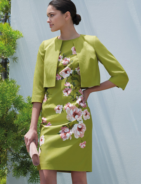 Green mother of the bride dress with pink flowers and matching green jacket
