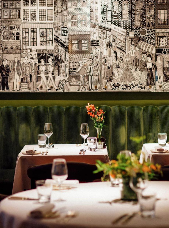 Tables set for dinner at Quo Vadis restaurant in London.